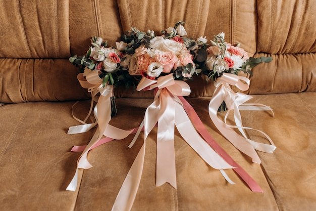 Three holiday bouquets stand on a sofa