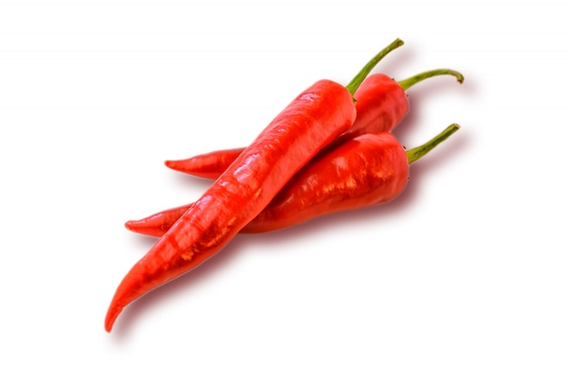 Three hot chilly pepper on the white