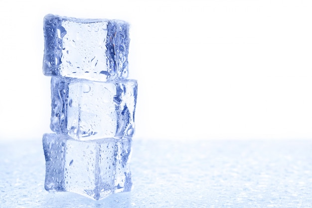 Three ice cubes on the glass.