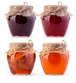 白にジャムと蜂蜜の3つの瓶