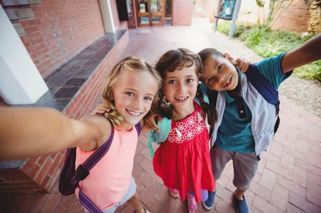 Three kids photographed like a selfie