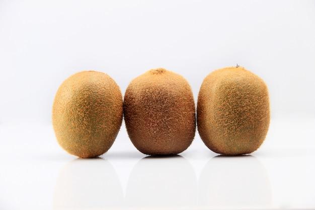 Three kiwifruit isolated on white