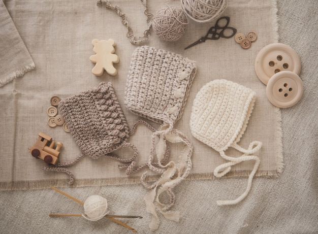 Three knitted baby hats
