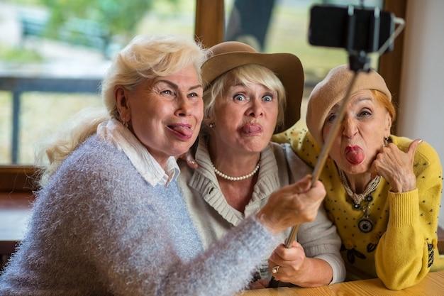 Three ladies taking selfie