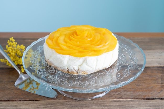 Three milks dessert decorated with peaches in the shape of a rose. copy space. colombian recipe. pastry concept.