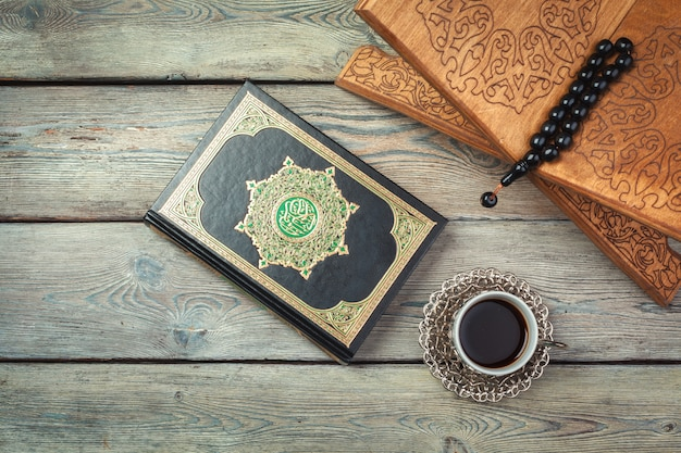 Three months. islamic holy book quran with rosary beads. ramadan concept