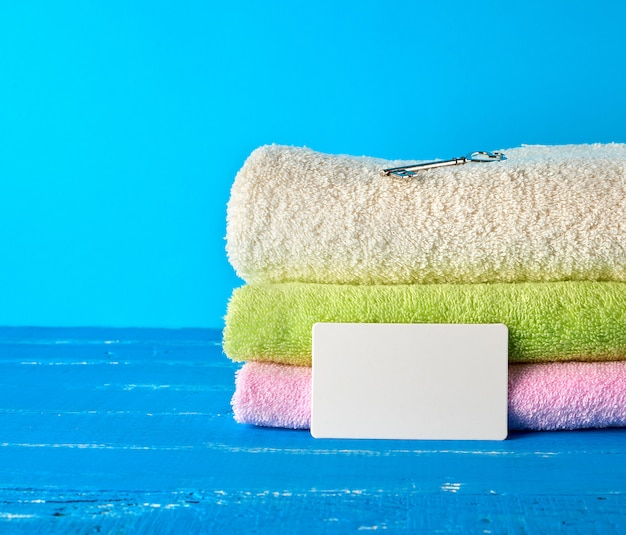 Three multi colored new terry bath towels folded