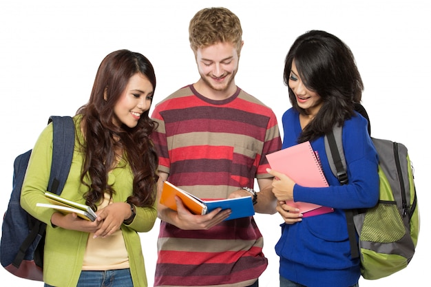 Three multicultural student, studying together