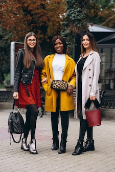Three multicultural women after shopping