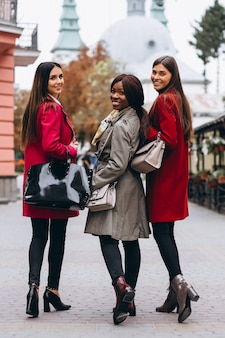 Three multicultural women in the street