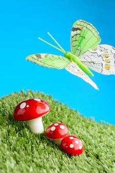 Три гриба на лугу и бабочка