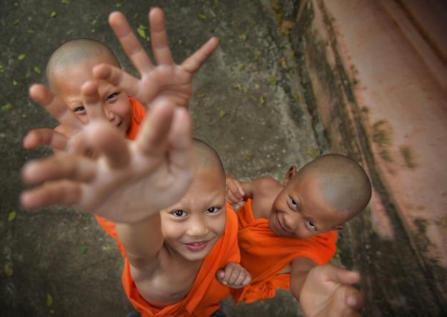 Three novices playing fun at phra nakhon si ayutthaya, thailand 3/12/61
