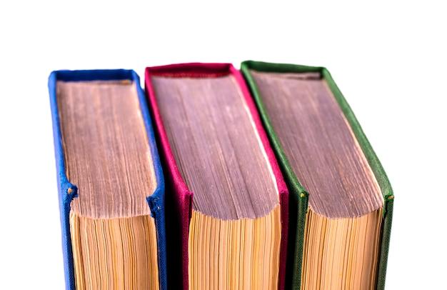 Three old books turned back side shot close-up