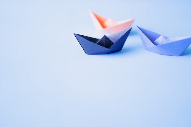 Three paper boat on clean background with copy space