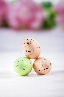 Three pastel easter eggs on a white background copy space