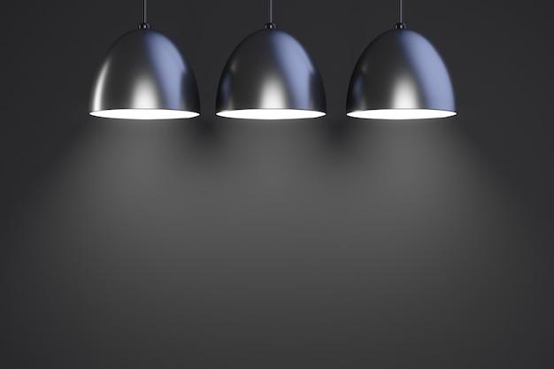 3つのペンダントランプが点灯します。スペースをコピーします。暗い背景。