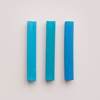 Three pieces of blue pastel crayon chalks