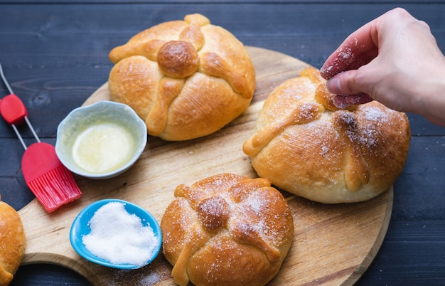 Three pieces of pan de muerto. day of the dead. mexican holiday. copy space. typical mexican food.