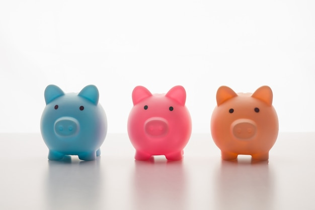 Three piggy bank isolated on white.