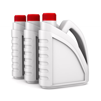 ホワイトスペースに3つのプラスチックキャニスターモーターオイル