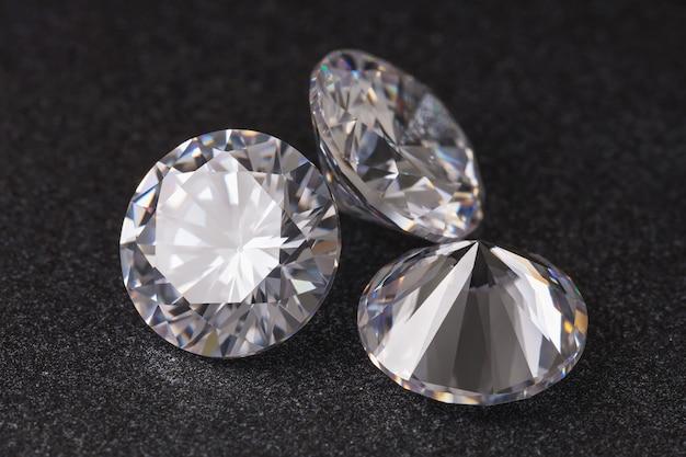 Three precious stones on a dark surface