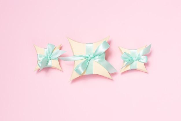 Three presents with light green ribbon, flat lay