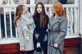 Three pretty girl in a winter city
