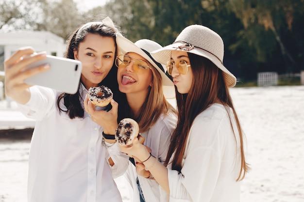 Three pretty girls in a summer park