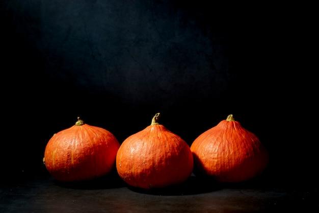 Three pumpkins in black