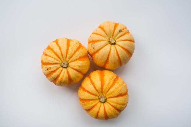 Three pumpkins on white background