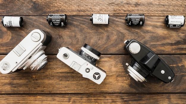 Three retro cameras near film