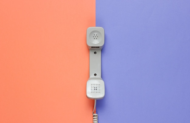 Three retro telephone handset on neon color