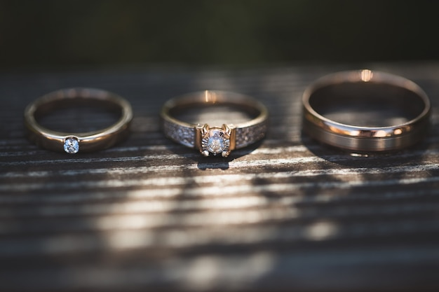 Three rings on wooden background