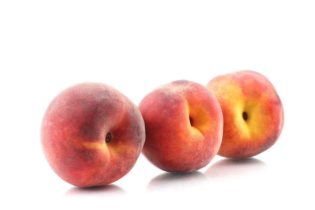 Three ripe peach on a white background