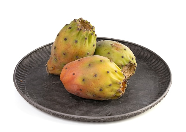 Three ripe prickly pears on a white background