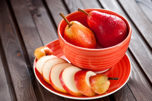 Three ripe red pears lie on a wooden table. the summer food. sweet pears.