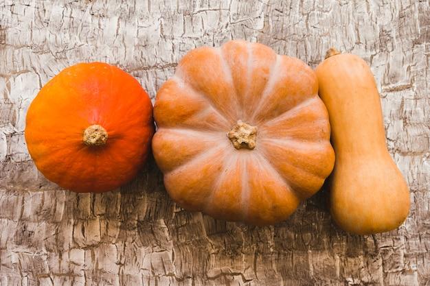 Three ripe squashes on table