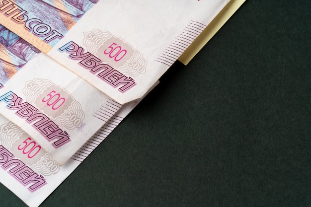 Three russian ruble banknotes  close up on black