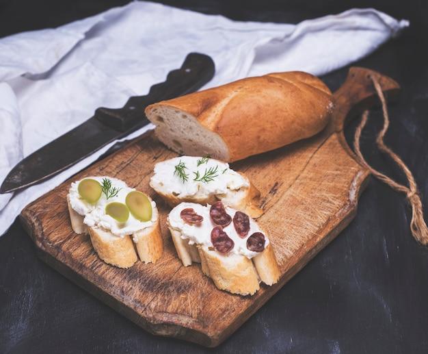 Three sandwiches with cream cheese