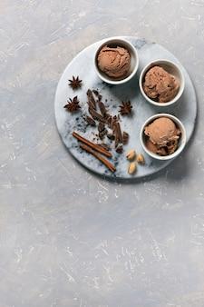 Three servings of chocolate ice cream