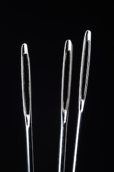 Three sewing needles without thread
