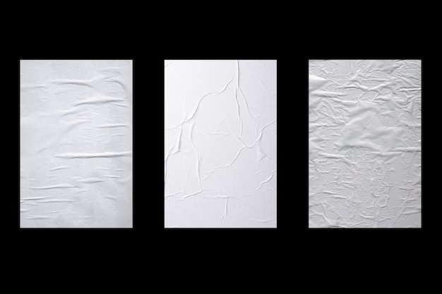 Three sheets of crumpled white paper isolated on black background.