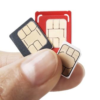 흰색 배경에 고립 손에 3 개의 sim 카드