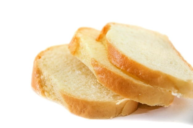 Three slices of white bread on a white background