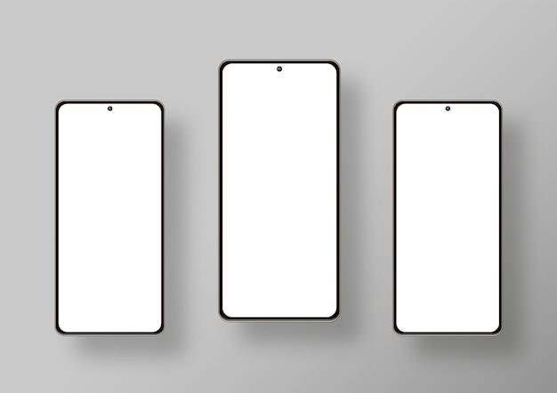 Three smartphones in grey background