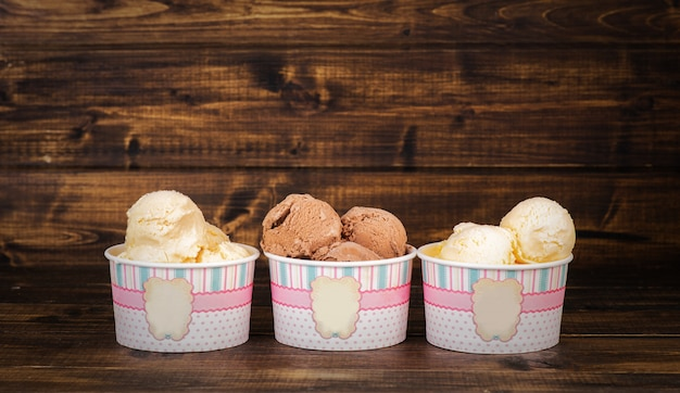 Three sorts of homemade ice cream in paper cups