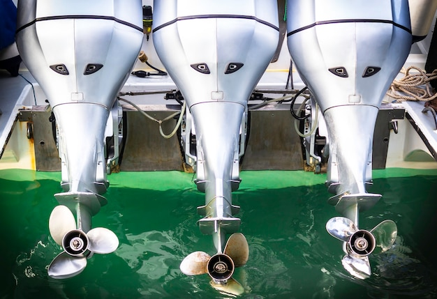 Three speed boat engine with propeller