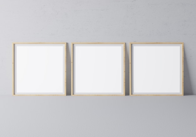 Three square wooden frames in modern design on minimal gray wall
