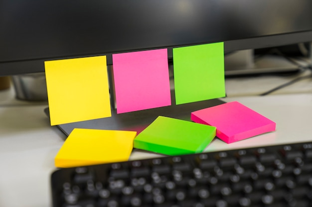 Three sticky notes on computer