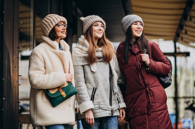 Three students in winter outfit at the street